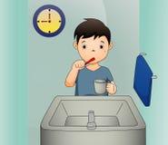 Een vectorillustratie van een jongen die zijn tanden borstelen stock illustratie