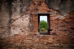 Een venster op de rode bakstenen muur Stock Fotografie
