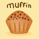 Een vers gebakken muffin bij de gele achtergrond Stock Fotografie