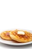 Een verticaal beeld van twee bevroren wafels met boter Stock Foto