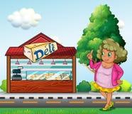 Een vette dame voor de delicatessenwinkelopslag Stock Foto
