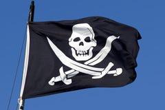 Een vlag van het piraatschip. Stock Afbeeldingen