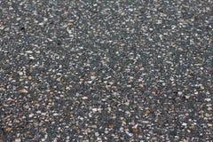Een vlotte donkere grijze textuur van de asfaltbestrating Stock Afbeelding