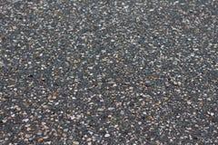 Een vlotte donkere grijze textuur van de asfaltbestrating Stock Foto