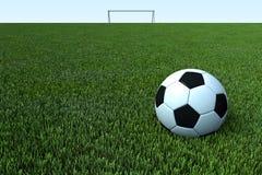 Een voetbal, een voetbalbal op groen grasgebied Royalty-vrije Stock Afbeelding