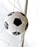Een voetbalbal in het doel royalty-vrije stock afbeelding