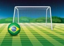 Een voetbalbal met de vlag van Brazilië stock illustratie