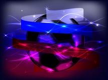 Een voetbalbal is verpakt met een lint in de vorm van een vlag van Rusland Stock Fotografie