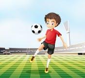 Een voetbalster in zijn rood uniform royalty-vrije illustratie