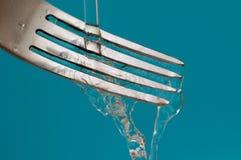 Een vork en een water - hygiëne stock foto