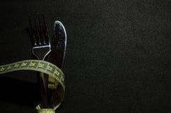 een vork met het meten van band royalty-vrije stock afbeeldingen