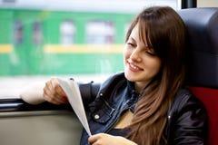 Een vrouw in de trein Stock Fotografie