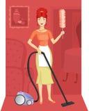 Een vrouw met een stofzuiger Stock Foto