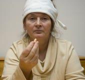 Een vrouw met hoofdpijn Stock Foto