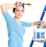 Een vrouw op een trapladder Royalty-vrije Stock Foto's