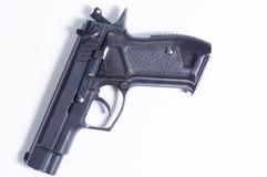 Een vuurwapen op een witte achtergrond Isoleer kanon stock afbeelding