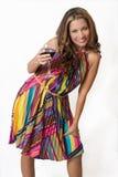 Een wellustig brunette met een glas rode wijn Stock Fotografie
