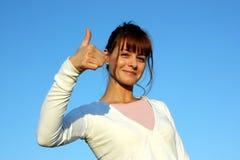 Een witte vrouw op een blauwe hemel Royalty-vrije Stock Afbeelding