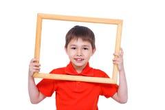 Een y.o. jongen 6 met een frame stock afbeeldingen