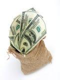 Een zakhoogtepunt van contant geld Royalty-vrije Stock Afbeeldingen