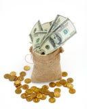 Een zakhoogtepunt van contant geld Stock Foto's