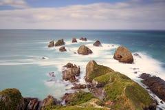 Een zeegezicht van Goudklompjepunt wordt geschoten, Nieuw Zeeland dat Royalty-vrije Stock Foto's