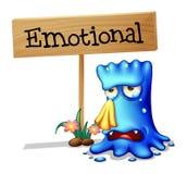 Een zeer emotioneel monster dichtbij een uithangbord Stock Foto's