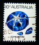 Een zegel in Australië wordt gedrukt toont een beeld van de blauwe steen van de stersaffier op waarde bij cent die 10 Royalty-vrije Stock Afbeeldingen