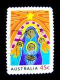 Een zegel in Australië wordt gedrukt toont een beeld van de geboorte van Christus in kunstkleur het schilderen op waarde bij cent Stock Afbeeldingen