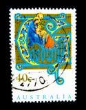 Een zegel in Australië wordt gedrukt toont een beeld van de geboorte van Christus op waarde bij cent die 40 Stock Afbeelding