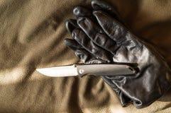Een zonglans op het blad van een mes Licht op het mes van het venster royalty-vrije stock afbeelding