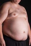 Een zwaarlijvige jonge mens Stock Afbeelding