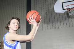 Eenager basketball player play his favorite sport Royalty Free Stock Photo