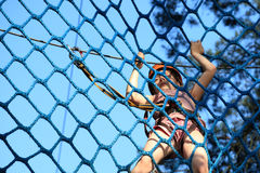 Eenager climbing a rope park, Girl climbing in adventure park Stock Image