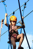 Tenager climbing a rope park, Girl climbing in adv Royalty Free Stock Photography