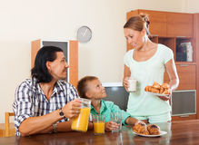 Eenager eating breakfast in home interior Royalty Free Stock Photo