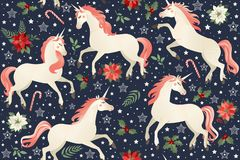 Eenhoorns op een Kerstmis bloemenachtergrond Naadloos patroon royalty-vrije illustratie