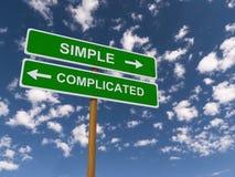 Eenvoudig versus ingewikkeld Stock Afbeeldingen