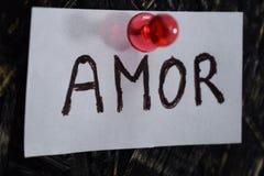 Eenvoudige en begrijpelijke inschrijving, liefde in het Spaans Stock Afbeelding