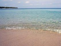 Eenzaam strand Stock Afbeeldingen