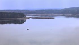 Eenzame boot op het meer Stock Afbeelding