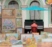 Eenzame straatmusicus Stock Foto