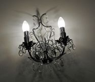Eerie candle wall lights gothic castle shadows Royalty Free Stock Images