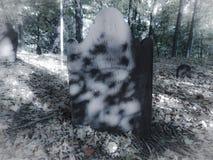 Eerie grave stone Stock Photos