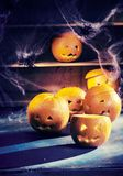 Eerie Halloween background with jack-o-lanterns royalty free stock images