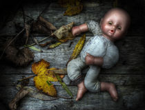 Eerie image of an abandoned doll. Eerie grunge / HDR image of an abandoned doll stock image