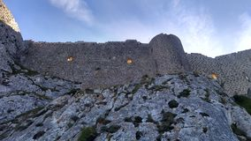 Eerie orange windows on castle ruins at Peyrepertuse in France royalty free stock photos