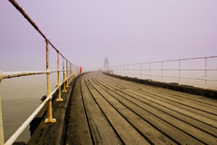 Whitby pier in fog Stock Photography