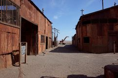 Humberstone Saltpeter Worksm in northern Chile. An eerie street in the abandoned Humberstone saltpeter works. This abandoned nitrate town was extremely important stock photos