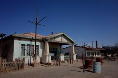 Humberstone Saltpeter Worksm in northern Chile. An eerie street in the abandoned Humberstone saltpeter works. This abandoned nitrate town was extremely important royalty free stock photography
